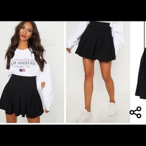 Black mini tennis pleated skirt
